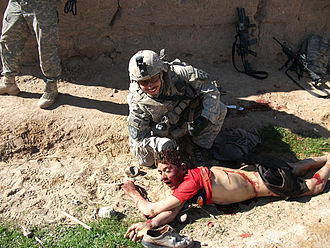 Maywand District murders - Jeremy Morlock poses with the body of Gul Mudin immediately after the boy was killed.