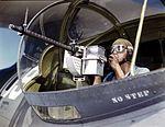 Jesse Rhodes Waller, A.O.M., third class, tries out a 30-calibre machine gun 1a34876v.jpg