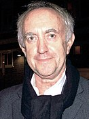 Jonathan Pryce looking to the camera