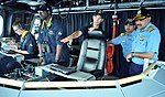 Joseph Gagliano, commanding officer of USS Independence (LCS 2) describes state-of-the-art features of the bridge during a ship tour for Rear Adm Ajendra B. Singh and Commodore Alok Bhatnagar from the Indian navy during RIMPAC 2014.jpg