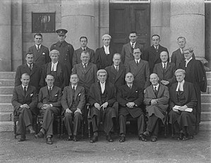 Jim Sealy - Portrait of Judge Sealy with lawyers and a Garda outside Waterford courthouse, c. 1944.
