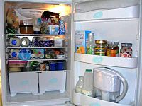 A typical refrigerator with its door open