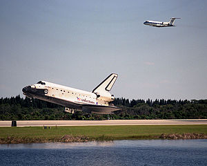 Shuttle Training Aircraft - A STA flying above Discovery as it lands at the conclusion of STS-95 in 1998
