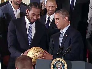 Kawhi Leonard - Image: Kawhi Leonard presents ball to President Obama 2 2015 01 12 cropped