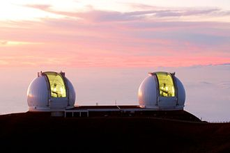 W. M. Keck Observatory - Left: The summit of Mauna Kea is considered one of the world's most important astronomical viewing sites. The twin Keck telescopes are among the largest optical/near-infrared instruments currently in use around the world. Middle: The night sky and Keck Observatory laser for adaptive optics. Right: W. M. Keck Observatory at sunset