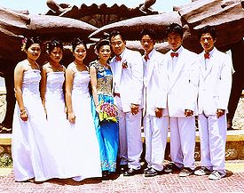 Three Groomsmen Stand To The Left Of Groom And Bridesmaids Right Bride In This Wedding Kep Cambodia