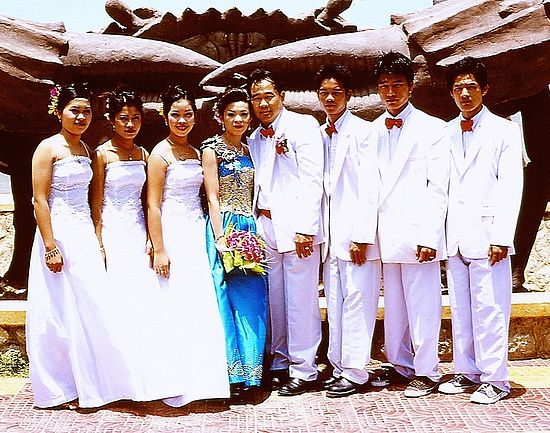Three groomsmen stand to the left of the groom and three bridesmaids stand to the right of the bride in this wedding in Kep, Cambodia. Kep wedding crop.jpg
