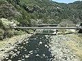 Kusugawa River and Ichinomurahashi Bridge from train of Kyudai Main Line.jpg
