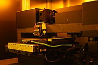Laser lithography writing head and table.JPG