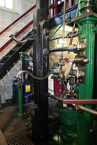 Tappet - Adjustable tappet block on the vertical plug rod of a beam engine at Leawood Pump House. It acts on the curved horn beneath it