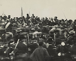 Ward Hill Lamon - Abraham Lincoln at Gettysburg (seated center, highlighted in sepia). Ward Hill Lamon is seated to Lincoln's right.