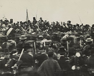 Gettysburg Address - One of the two confirmed photos of Lincoln (center, facing camera) at Gettysburg, taken about noon, just after he arrived and some three hours before his speech. To his right is his bodyguard, Ward Hill Lamon.