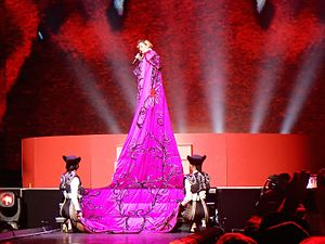 "Rebel Heart - The performance of ""Living for Love"" during the Rebel Heart Tour. For the song, Madonna wore a long cape similar to her costume during the Brit Awards."