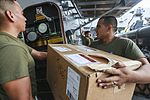 Mail call, U.S. Marines and Sailors sort packages 150815-M-TJ275-098.jpg