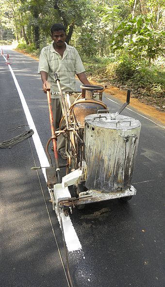 Line marking in rural India Making lines on the road.JPG