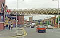 Manchester westward on Whitworth St. West at Deansgate station, 1992 geograph-3778394-by-Ben-Brooksbank.jpg