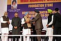 Manmohan Singh being presented a memento by the Chief Minister of Punjab, Shri Parkash Singh Badal, at the foundation stone laying ceremony of the Homi Bhabha Cancer Hospital and Research Centre, at Mullanpur, Mohali (1).jpg