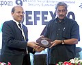 Manohar Parrikar being presented a memento by the Secretary (Defence Production), Shri A.K. Gupta, during the International Seminar on Advances in Shipbuilding Technology, organised at the Defexpo-16, in Goa.jpg