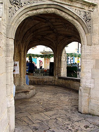 Malmesbury Market Cross - Interior view through one of the two doorway arches, showing the central bench, and two benched arches.