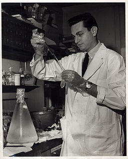Marshall Nirenberg performing experiment