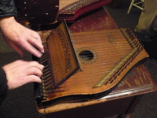 Marxophone Fretless zither played via a system of metal hammers