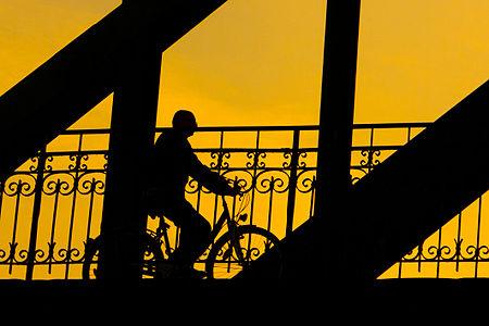 Silhouette of a cyclist crossing Mauterner Bridge