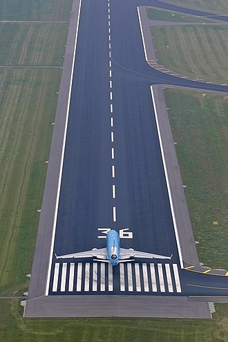 Runway - A MD-11 at one end of a runway