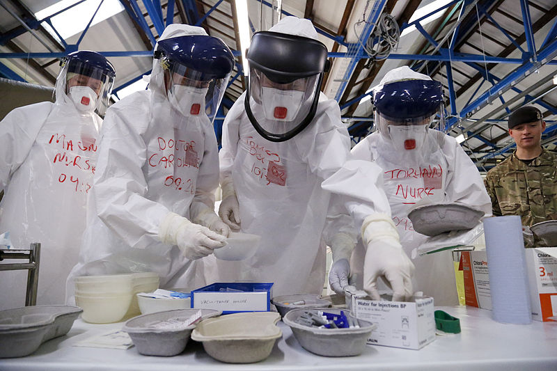 File:Medics from across the NHS practise in full Personal Protective Equipment (PPE) (15649499108).jpg