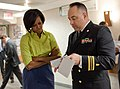 Michelle Obama is briefed by Lieutenant Commander Todd Hazlett, 2010.jpg
