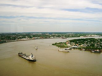 Algiers Point - Rounding Algiers Point A downbound ship and other vessels on the Lower Mississippi River, with Algiers Point to the right