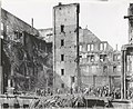 Missouri Athletic Club fire wreckage at the northwest corner of Fourth Street and Washington Avenue. Workers and spectators standing on the third floor of the building.jpg