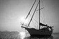Monochrome yacht and sun (Unsplash).jpg