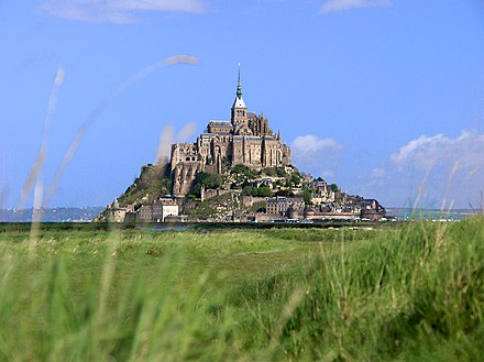 The medieval island of Mont-Saint-Michel, the most visited monument in Normandy Mont Saint Michel bordercropped.jpg