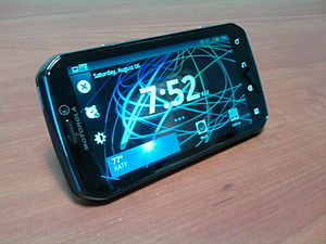 A Motorola Photon 4G sitting on its side with ...