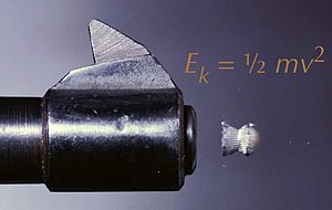 Muzzle energy - Pellet exiting muzzle, with formula for energy overlaid.