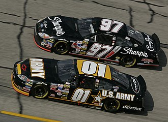 Joe Nemechek - Nemechek (No. 01) racing against Kurt Busch at Talladega Superspeedway in 2005