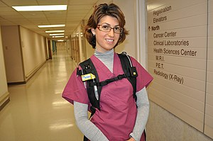 Health professional - A healthcare professional wears an air sampling device to investigate exposure to airborne influenza