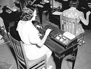 "Keypunch - ""A good operator can turn out 1,500 punch cards daily."" Operators compiling hydrographic data for navigation charts on punch cards using the IBM Type 016 Electric Duplicating Key Punch, New Orleans, 1938."