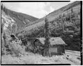 NORTHWEST REAR, SOUTHWEST SIDE, WITH CREEK BELOW - Vincent Knorr Cabin, Bettles, Yukon-Koyukuk Census Area, AK HABS AK,23-BET.V,2-1.tif