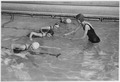 NYA-Ada County Boise, Idaho-Miss Betty Klinger, teaching a class in swimming at the Y pool-through the help of the... - NARA - 197136.tif