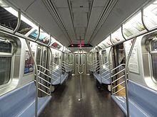 The interior of R160 car 9800, which has experimental looped stanchions