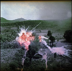Role of the United States in the Vietnam War - U.S. aircraft bombs NLF positions in 1965.