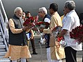 Narendra Modi being received by the Governor of Gujarat and Madhya Pradesh, Shri O.P. Kohli, the Chief Minister of Madhya Pradesh, Shri Shivraj Singh Chouhan and the Union Minister for Defence, Shri Manohar Parrikar.jpg