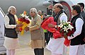 Narendra Modi being welcomed by the Governor of Uttar Pradesh, Shri Ram Naik, on his arrival, at Lucknow airport, in Uttar Pradesh. The Union Home Minister, Shri Rajnath Singh and the Chief Minister of Uttar Pradesh.jpg