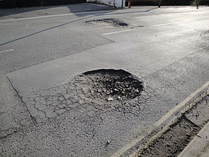 Pothole  Wikipedia Example Of A Pothole Reappearing On A Newly Patched Roadway Also Showing  The Transition Between Crocodile Cracking And The Pothole With Water Dried  Up  Extended Essay Topics English also Example Of Essay With Thesis Statement  Essay With Thesis Statement Example
