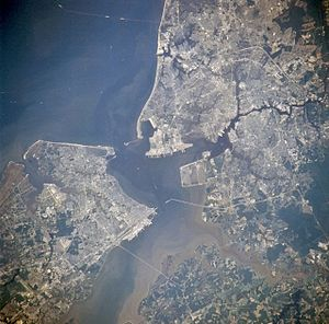 Norfolk, Virginia - Newport News, Hampton, Isle of Wight County, Suffolk, Chesapeake, Portsmouth and Norfolk, Virginia from space, July 1996. Norfolk is located in the upper right quadrant, and east is at the top.