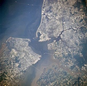 Portsmouth, Virginia - Newport News, Hampton, Portsmouth and Norfolk, Virginia from space in July 1996. (Portsmouth is in the center right portion of the photo)