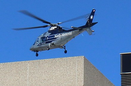 Air ambulance landing at HCMC in downtown Minneapolis North Memorial AirCare 20161018.jpg