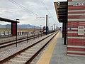 Northbound TRAX Red Line train departing Daybreak Parkway station, Apr 16.jpg