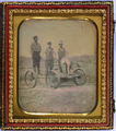 Occupational Portrait of Three Railroad Workers Standing on Crank Handcar.png